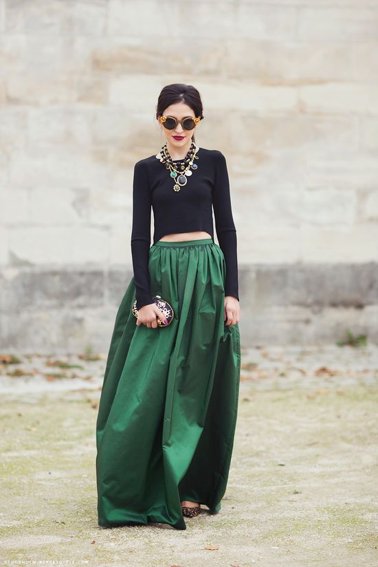 Evergreen skirt with black crop top and statement necklaces