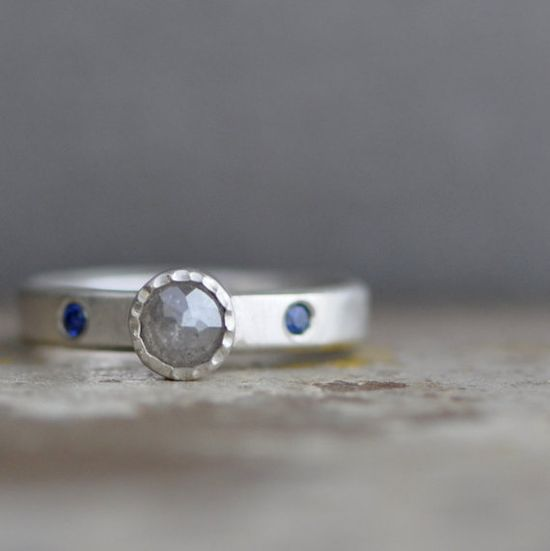 Frosted diamond and cool blue sapphire pair beautifully in this engagement ring.