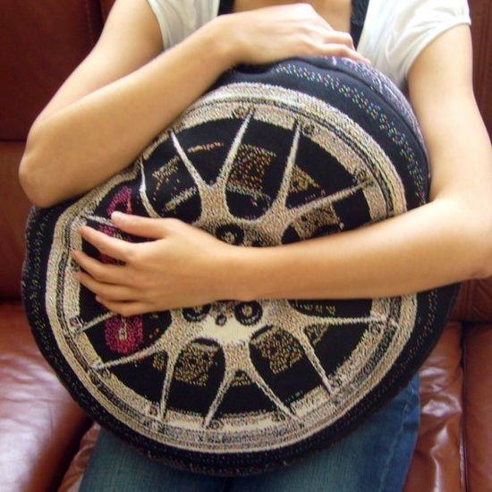 I know its a cushion - but it looks like a car tyre - Luxury Sport Car Wheel Pillow by chicsindesigndotcom on Etsy,