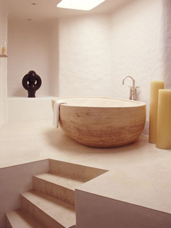 SPI commissioned this sculptural solid stone, oversized tub in France. Weighing over three tons, the tub had to be lowered into the bathroom with a crane via the skylight since it would not fit through the bathroom door.