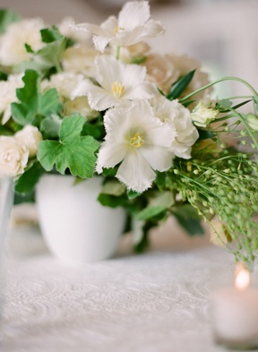 white flowers for table tops, look lovely for a vintage wedding.