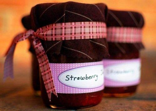Mason jar filled with strawberry jam - cute wedding favor for a rustic wedding.