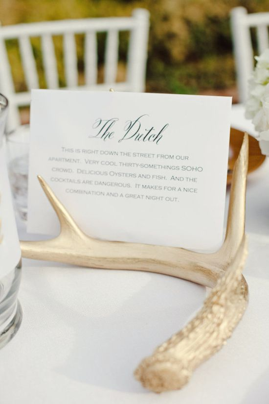 gilded antlers and tables named after the couple's favorite restaurants make for a super glam and oh so gorgeous tablescape  Photography by jnicholsphoto.com, Wedding Coordination and Design by mistyduncanevents...