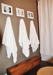 Bathroom Decorating Ideas - Bing Images... Got the towel hooks, just need to add the pic's! (maybe)
