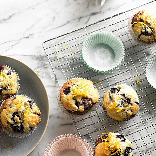 Orange and lemon zest add a boost of flavor to these blueberry muffins. More recipes from the magazine: www.bhg.com/...