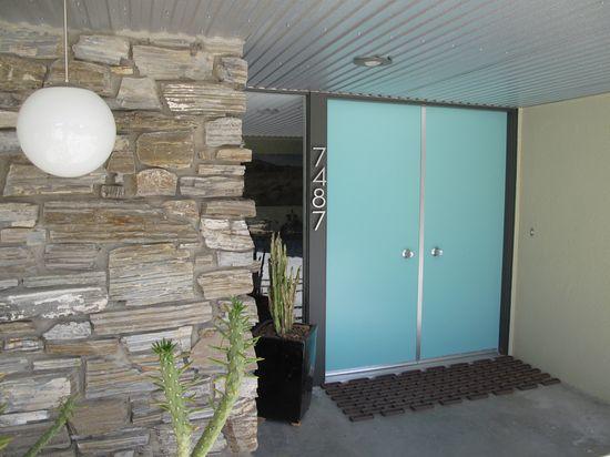 GORGEOUS steel Mid Century Modern front doors.
