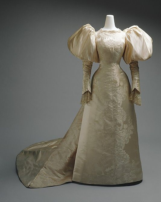 Wedding Dress  House of Worth  (French, 1858–1956)    Date:      1896  Culture:      French  Medium:      silk, pearl  Dimensions:      [no dimensions available]  Credit Line:      Gift of Miss Agnes Miles Carpenter, 1941  Accession Number:      C.I.41.14.1