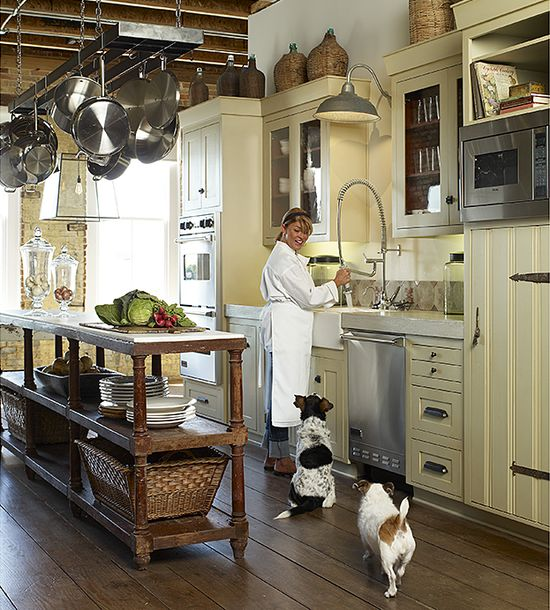 Pro chef style kitchen w/ 18th c. French drapers table as island; Healey Grisham.