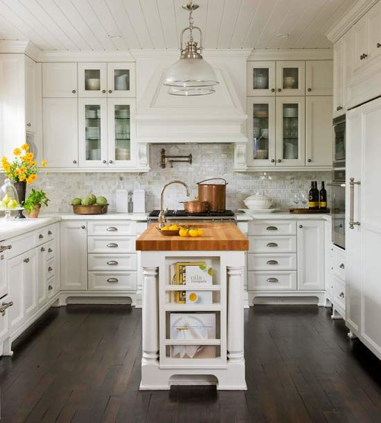 We love this white kitchen with a chef-friendly butcher-block island. More island ideas: www.bhg.com/...