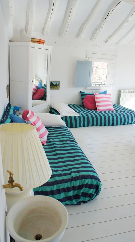 fun and simple kids' room. Like the mattresses on the floor as a big kid bed transition.