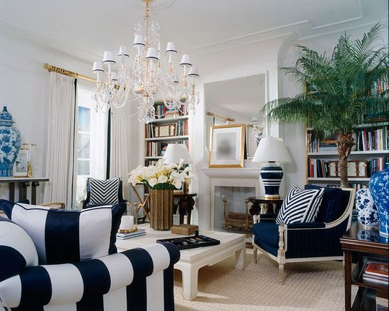 Just Lovely!  This Ralph Lauren Living Room is brilliant! I love the elegant kick of blue and tropical touches. The blue and white stripes are  carried through the space beautifully. The gold accents add a touch of glamour.
