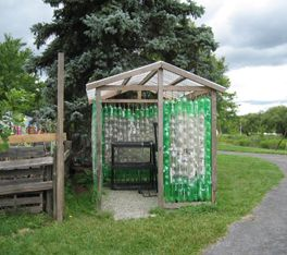 I'd never make this in a million years, but I admire the ingenuity that some people have.    Plastic bottle greenhouse