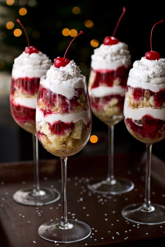 Party In A Glass Parfait - Grand Marnier-Soaked Pound Cake, Raspberries and Chambord Whipped Cream, topped with Maraschino Cherries and Edible Silver Confetti