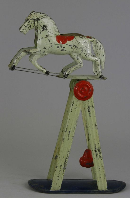 MERRIAM BALANCING HORSE TOY  Pat. Jan. 25, 1870, early American tin toy features two horses side by side, able to rock forwards & backwards on weighted support