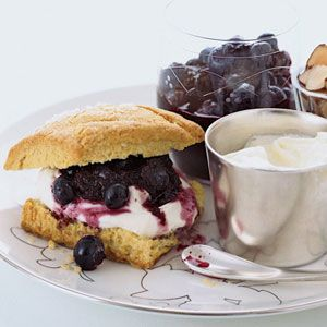 Almond flour gives these not-too-sweet biscuits a subtle nutty flavor; cornmeal adds a bit of crunch. Instead of whipped cream, Barry Maiden serves the biscuits with two sweet-tangy accompaniments: whipped creme fraiche and blueberry sauce.