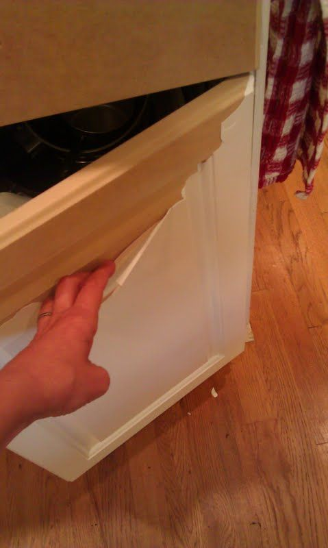 Peeling laminate off cabinets and painting underneath.