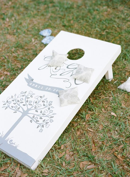 Play wedding lawn games with a custom corn toss platform