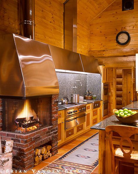 rustic corner fireplace in the kitchen....