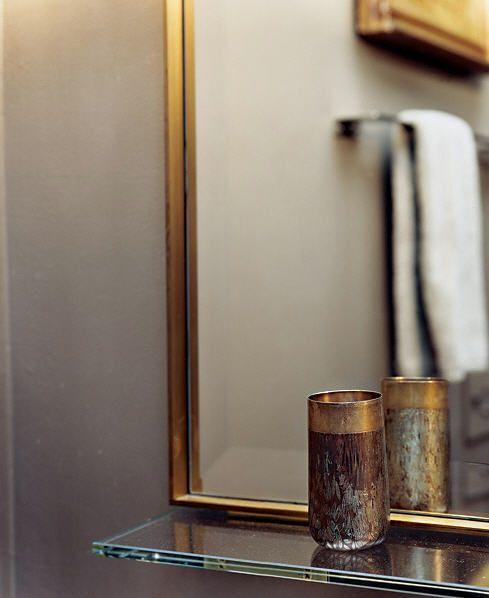 Brass mirror with glass shelf.