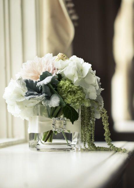 white simple and elegant reception wedding flowers,  wedding decor, wedding flower centerpiece, wedding flower arrangement, add pic source on comment and we will update it. www.myfloweraffai... can create this beautiful wedding flower look.