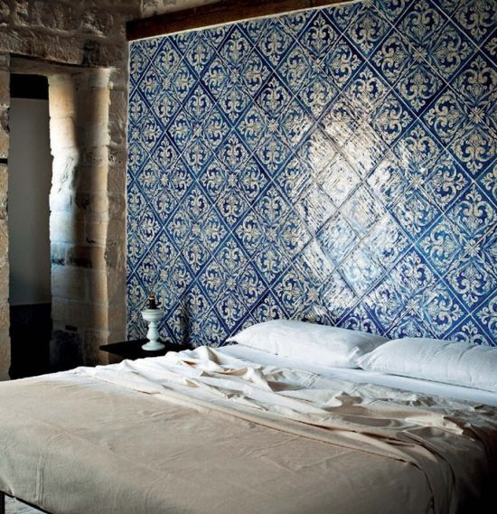 Bedroom with blue tiled wall