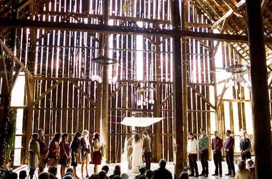 Ceremony in a barn with light streaming in