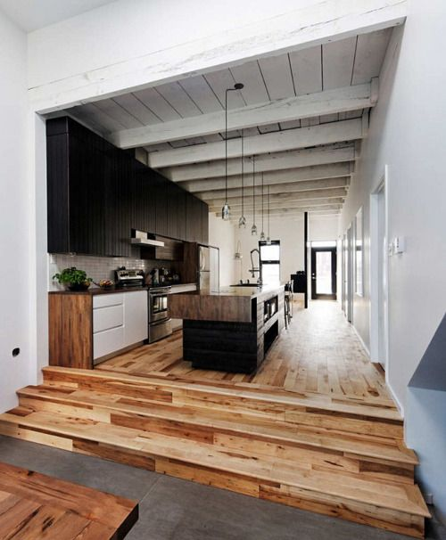 Kitchen, timber flooring, exposed timber rafters, black joinery. Beautiful muted palette
