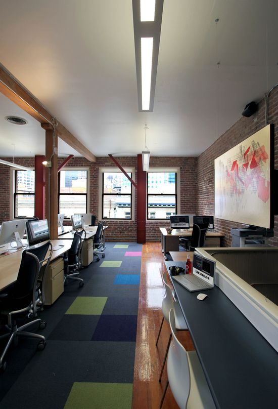 Batch office; open floor plan with shared desk space.  cool carpet