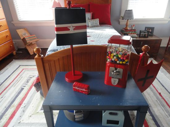 "Boy's bedroom decorated in red, white, and blue, with ""Army"" guy stuff and other vintage touches."