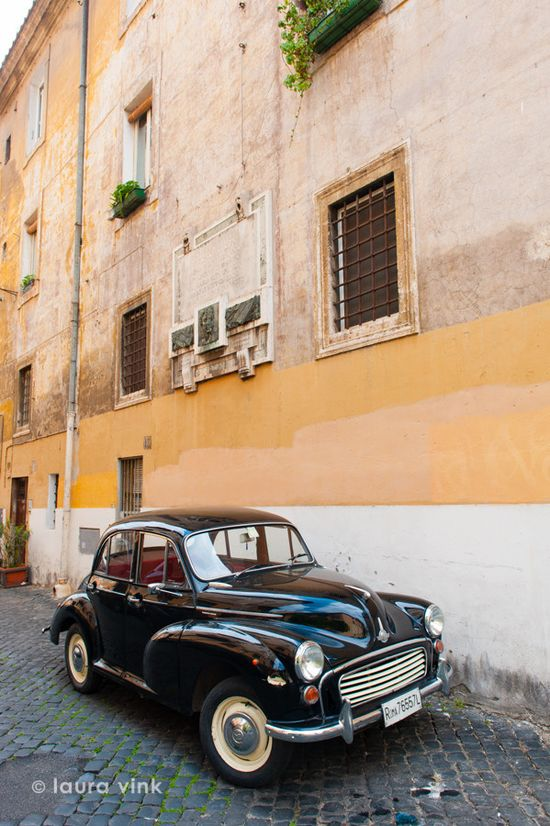 A classic car in the streets of Rome
