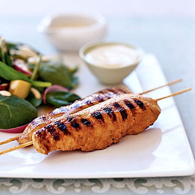 Grill up this Yogurt-and-Spice Grilled Chicken Skewers for some yummy finger food. Only 210 calories per skewer.