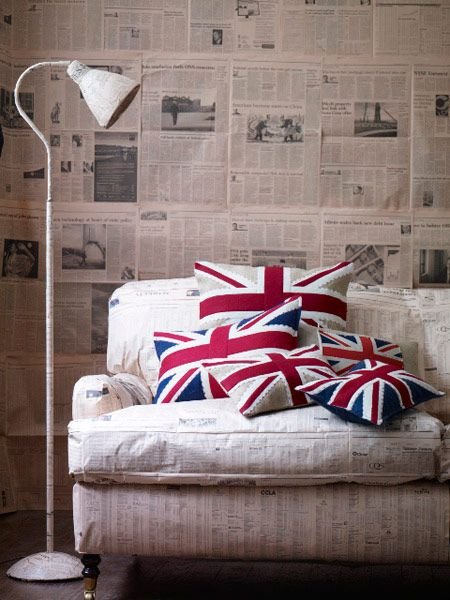 Newspaper walls and union jack pillows. Love.