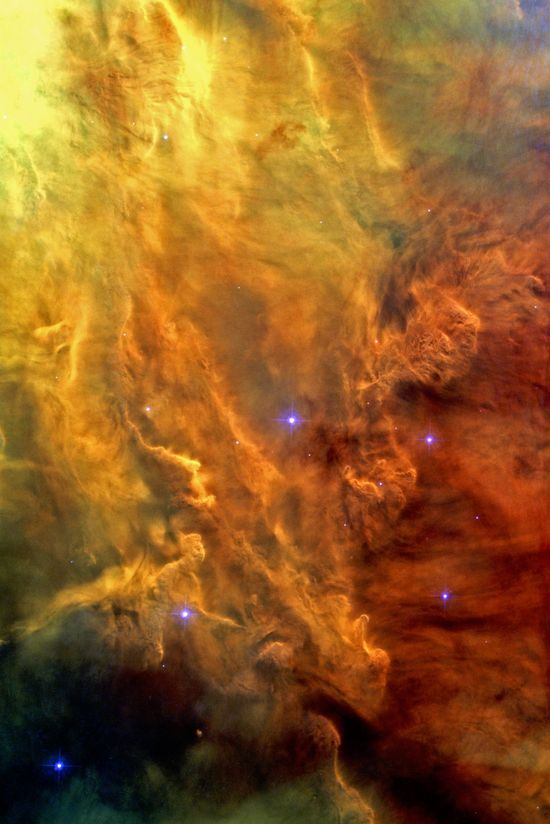 A spectacular Hubble Space Telescope image reveals the heart of the Lagoon Nebula. Seen as a massive cloud of glowing dust and gas, bombarded by the energetic radiation of new stars, this placid name hides a dramatic reality.  The Advanced Camera for Surveys (ACS) on the NASA/ESA Hubble Space Telescope has captured a dramatic view of gas and dust sculpted by intense radiation from hot young stars deep in the heart of the Lagoon Nebula (Messier 8).
