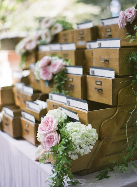 Seating cards presented in an old library catalog drawer. #library #wedding