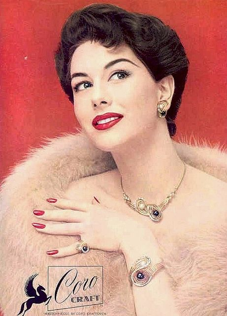 A terrifically lovely model sports Coro Craft jewelry in this ad from 1956. #vintage #fashion #1950s #ad #jewelry