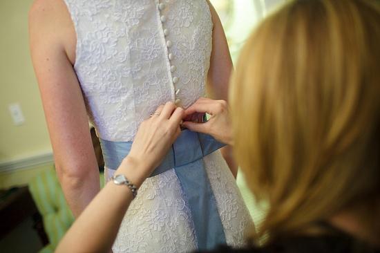 Lace dress back: Mignonette Bridal.