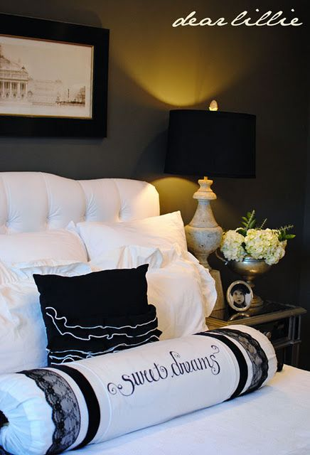 The colors: White, beige and black with dark grey walls and yellow accents - love it!