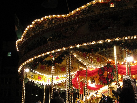 Carousel in the German Christmas market in Victoria Square, Birmingham by Yee Ting Kuit