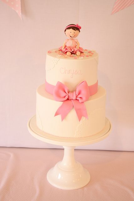 Pretty bow first birthday cake by Cake Ink. (Janelle), via Flickr