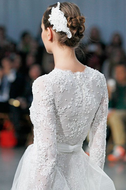 A knotted bun wedding hairstyle from Monique Lhuillier, Fall 2013