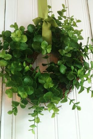 Use an upside down Command hook on the backside of a door to hang a wreath