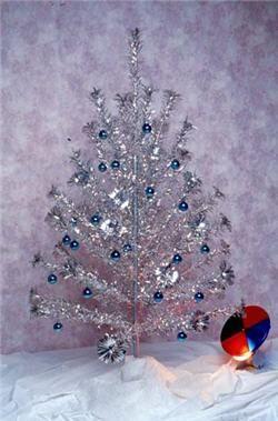 Silver aluminum Christmas tree with a color disc! Sooooooooo tacky!!