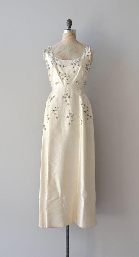 Heavy silk satin silver beaded, low v backed 1969's wedding dress