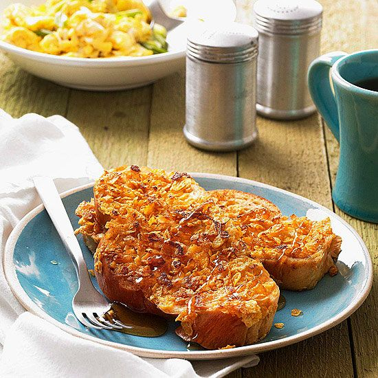 Crispy-Coated Orange French Toast - Thick challah bread is topped with cornflakes, then dipped in an orange liqueur-egg mixture for a breakfast treat your crowd will love. More delicious brunch recipes: www.bhg.com/...