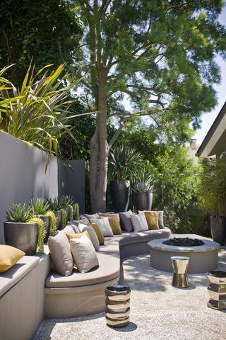 Backyard with fire pit and comfy seating