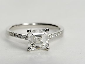 Elegant and graceful, this engagement ring setting showcases pavé-set diamonds in a slim platinum cathedral ring design to frame your center diamond.  #bluenile