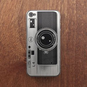 Vintage camera case for iPhone 4/4S. If I bought all these iPhone cases I've seen and liked, I would have a different one every day for a year.