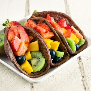 Fruit tacos with chocolate tortillas recipe. Can't tell if I really want to eat these or if I am just attracted to the pretty rainbow of fruit.... want anyway.