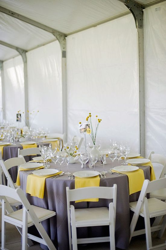 Gray linens and simple yellow napkins.