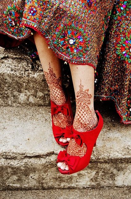 Embroidered dress, henna on your feet and killer red high heeled shoes...and what looks like a beautiful old city!